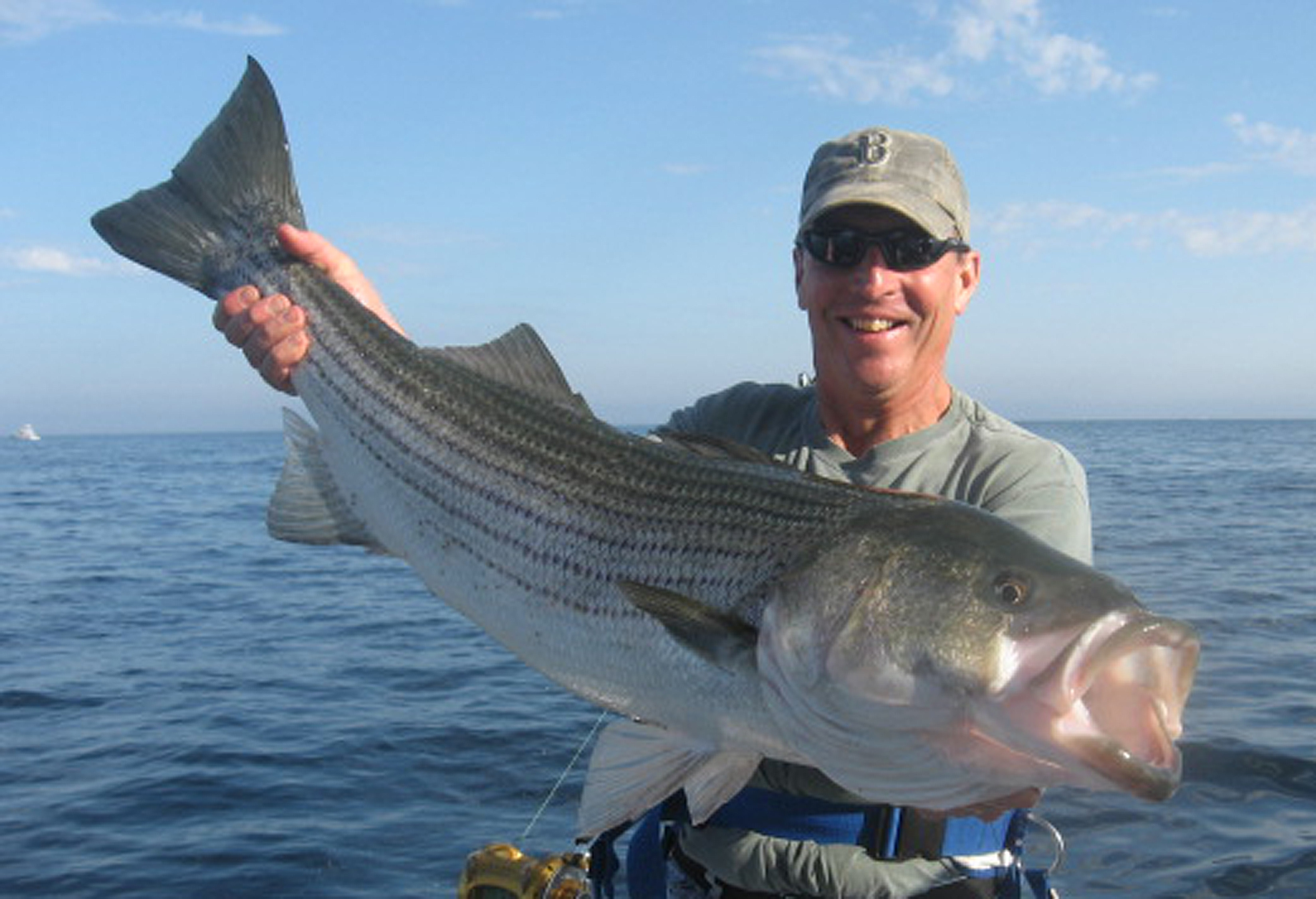 Fishing charters for tuna shark cod and striped bass in for World of fishing